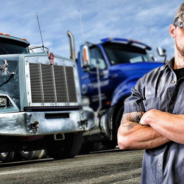 Trucker Man showing off trucks