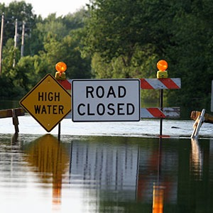Flooded Road with Closed Signs