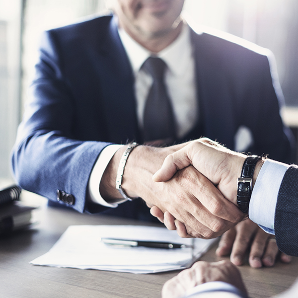 Business men shaking hands over a contract