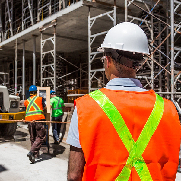 Construction workers supervising construction site