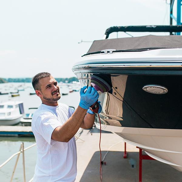 Person polishing boat yacht